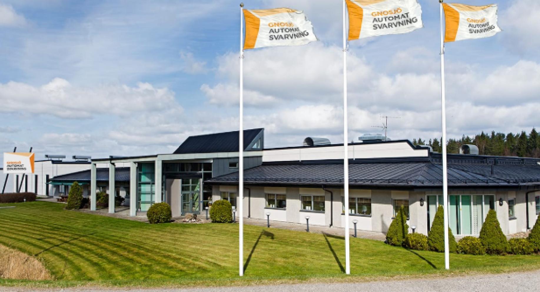 Gnosjö Automatsvarvning extern bild med flaggor